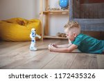preschool  boy playing with toy ... | Shutterstock . vector #1172435326