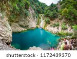 Natural Waterfall And Lake In...