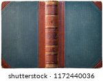 Old open book cover with embossed leather spine, cloth boards and abstract geometric decorations - circa 1909 - isolated on white