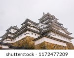 himeji castle on rainy day in... | Shutterstock . vector #1172477209