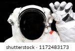 astronaut in spacesuit raised... | Shutterstock . vector #1172483173