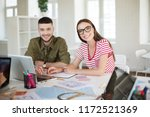 young man and woman in striped... | Shutterstock . vector #1172521369