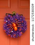 purple halloween wreath on a...