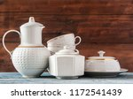 ceramic teapot  a stack of cups ... | Shutterstock . vector #1172541439