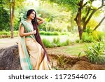 beautiful indian woman with...   Shutterstock . vector #1172544076