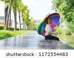woman holding an umbrella and... | Shutterstock . vector #1172554483