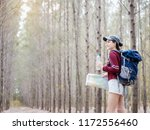 young woman carry a backpack... | Shutterstock . vector #1172556460