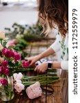 florist makes a bouquet. | Shutterstock . vector #1172559979