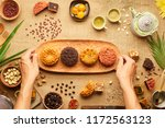 baker putting wooden plate with ... | Shutterstock . vector #1172563123
