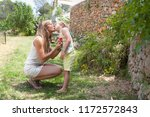 mother and son in holiday villa ... | Shutterstock . vector #1172572843