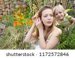 teenage girl and young brother... | Shutterstock . vector #1172572846