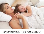mother and young daughter child ... | Shutterstock . vector #1172572870