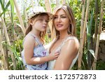 fashionable mother carrying... | Shutterstock . vector #1172572873
