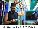 man using smart phone while... | Shutterstock . vector #1172598043