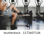 fitness man with towel tired... | Shutterstock . vector #1172607136