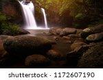 waterfalls in a moody  dark... | Shutterstock . vector #1172607190