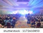 blur of light in the show room... | Shutterstock . vector #1172610853