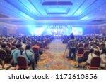 blur of light in the show room... | Shutterstock . vector #1172610856