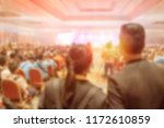 blur of couples and light in... | Shutterstock . vector #1172610859