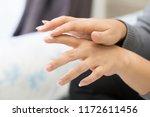 closeup of young woman applying ... | Shutterstock . vector #1172611456