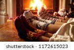 family in warm woolen socks... | Shutterstock . vector #1172615023