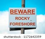 beware rocky foreshore warning...   Shutterstock . vector #1172642359