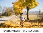 kid play with fallen yellow...   Shutterstock . vector #1172659003