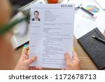 a businessman holds a resume in ... | Shutterstock . vector #1172678713