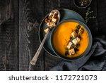 pumpkin soup served in a bowl... | Shutterstock . vector #1172721073