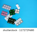 different pills on blue... | Shutterstock . vector #1172729680