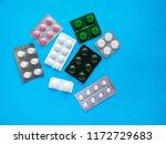 different pills on blue... | Shutterstock . vector #1172729683