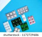 different pills on blue... | Shutterstock . vector #1172729686