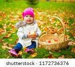 happy baby girl  with a basket... | Shutterstock . vector #1172736376