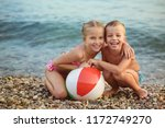 brother and sister playing ball ... | Shutterstock . vector #1172749270