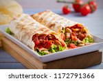 chicken bacon wraps with... | Shutterstock . vector #1172791366