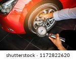 Asian Man Car Inspection...