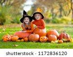 children in black and orange... | Shutterstock . vector #1172836120