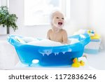 happy laughing baby taking a... | Shutterstock . vector #1172836246
