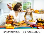 mother and daughter cutting... | Shutterstock . vector #1172836873