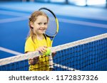 child playing tennis on indoor... | Shutterstock . vector #1172837326