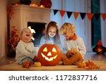 kids carving pumpkin on... | Shutterstock . vector #1172837716