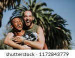 gay couple hugging in the park | Shutterstock . vector #1172843779