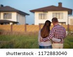 couple looking at their house | Shutterstock . vector #1172883040