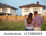 couple looking at their house | Shutterstock . vector #1172883043