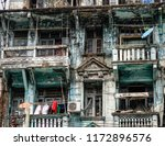 ruined apartment in yangon ... | Shutterstock . vector #1172896576