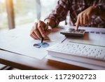 businessman working on... | Shutterstock . vector #1172902723