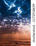 sunlight rays strikes on sea... | Shutterstock . vector #1172918659