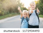 two heerful blondy boys gives a ... | Shutterstock . vector #1172934493