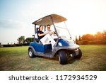 couple in driving buggy on golf ...   Shutterstock . vector #1172934529