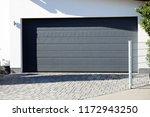 modern new garage door ... | Shutterstock . vector #1172943250